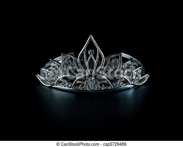 Tiara or diadem with reflection on dark background - csp5729489