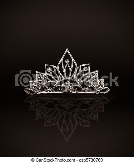 Tiara or diadem with reflection on dark background - csp5730760
