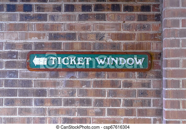 Ticket Window sign against a brick wall - csp67616304