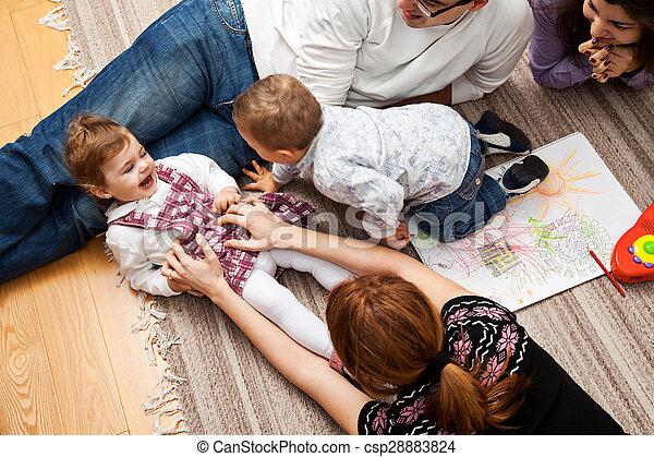 tickling a babe girl family - csp28883824