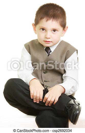 Tidy kid legs crossed - csp2692034