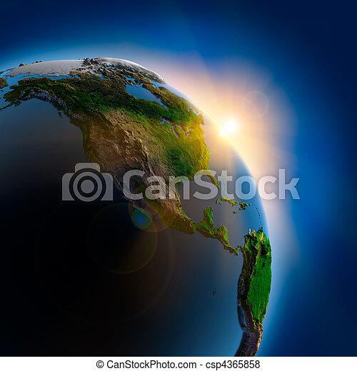 Al amanecer sobre la Tierra en el espacio exterior - csp4365858