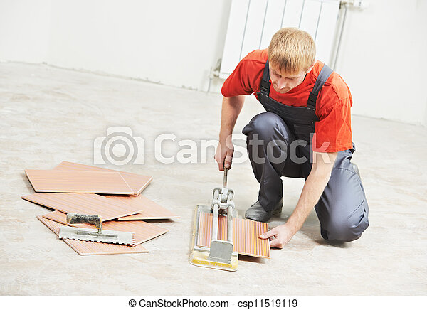 tiler cutting tile at home renovation work - csp11519119