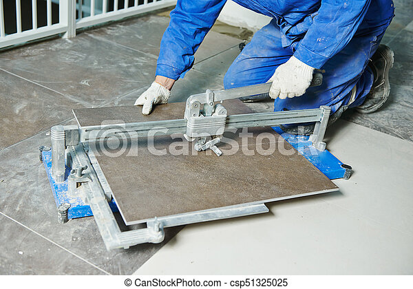 Tiler Working With Tile Cutting Equipment Industrial Tiler Builder