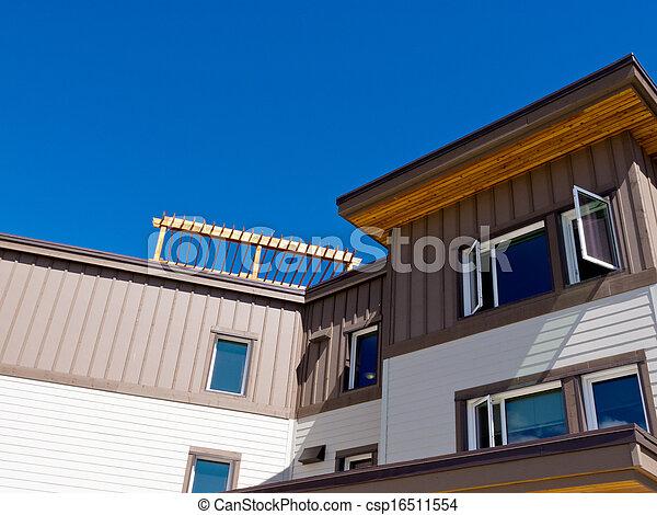 Timber clad condo building exterior upper storey - csp16511554