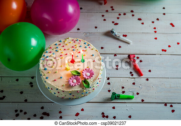 Time to blow out the candles from birthday cake - csp39021237