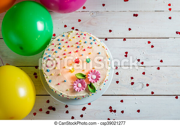 Time to blow out the candles in birthday party - csp39021277