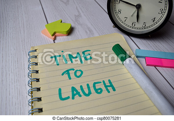 Time to Laugh write on a book isolated on Office Desk - csp80075281