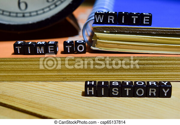 Time to write history written on wooden blocks. - csp65137814