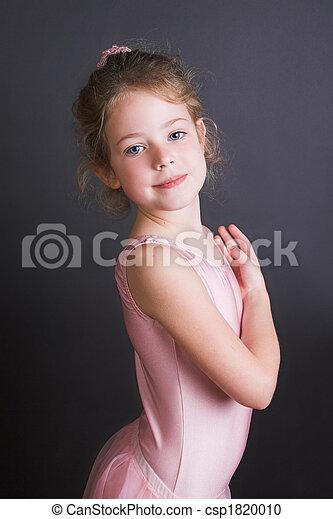 e0f3fbc7c55880 Tiny ballerina. Young ballet dancer wearing an leotard and skirt.