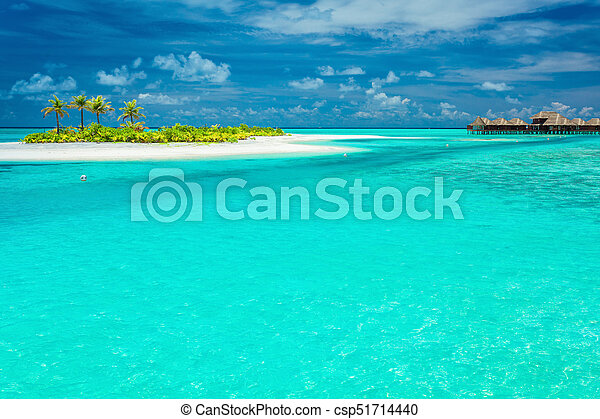 Tiny tropical island with palm trees in Maldives - csp51714440