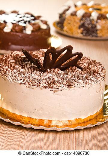 Tiramisu cake with cocoa powder decoration. on