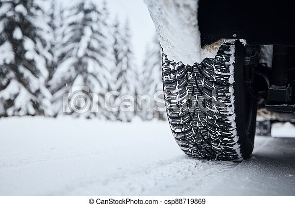 Tire of car on snow covered and icy road - csp88719869