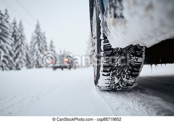 Tire of car on snow covered and icy road - csp88719852