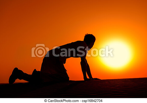 Tired and weaken man on all fours on sunset - csp16842704