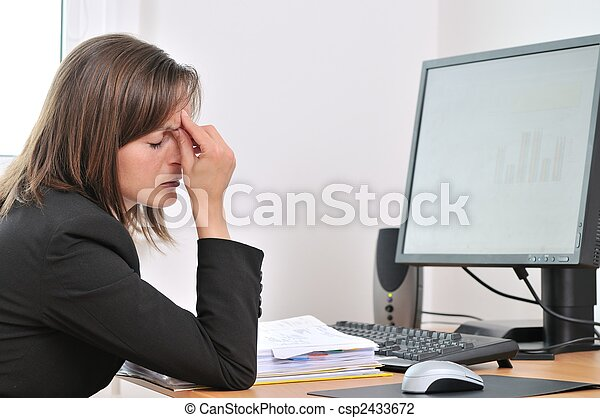 Tired business person with headache in work - csp2433672