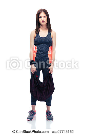 Tired cute woman standing with sports bag - csp27745162