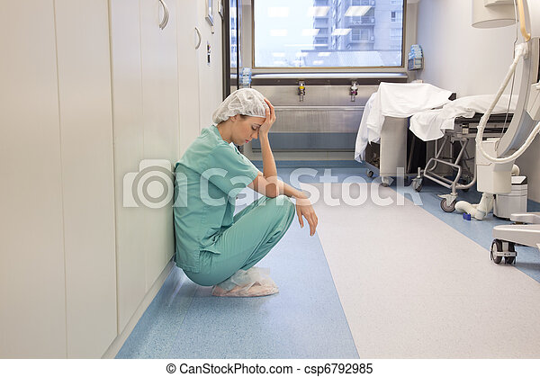 Tired Doctor in Hospital Hallway - csp6792985