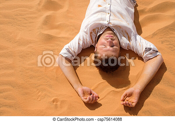 Tired man lying on the sand in a desert. - csp75614088