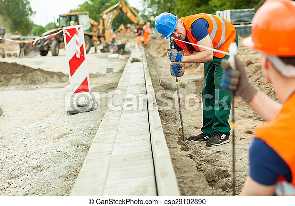 Tired road construction worker - csp29102890