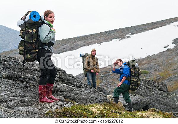 Tired team of backpackers in mountains with knapsacks - csp4227612
