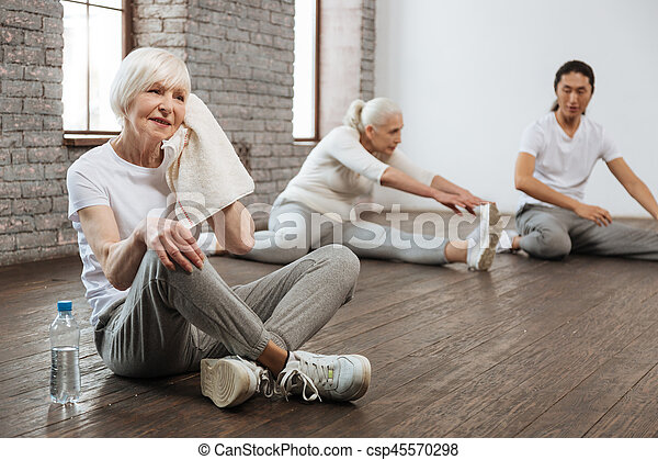 Tired woman wiping her face - csp45570298
