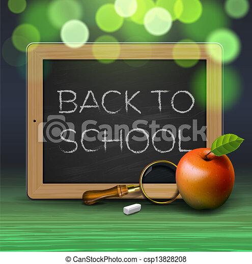 De vuelta a la escuela, escrita en pizarra con tiza - csp13828208