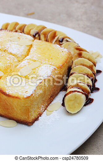 Toast topped with honey and ice-cream , banana - csp24780509