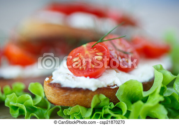 toast with cheese and cherry tomatoes - csp21870270