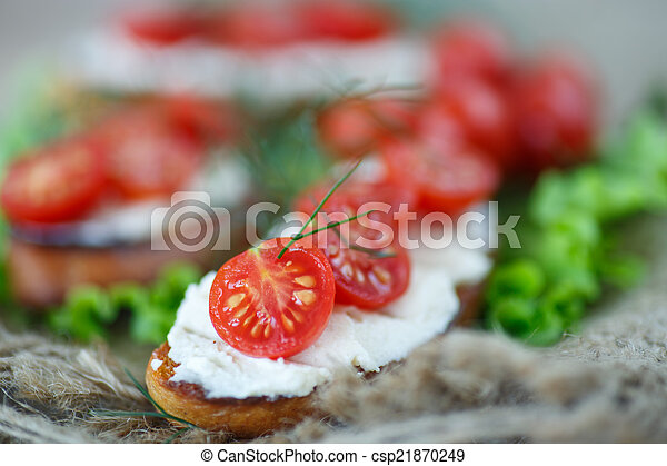 toast with cheese and cherry tomatoes - csp21870249