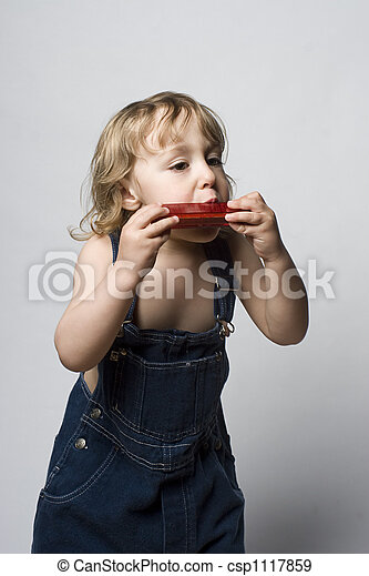 Toddle in overall and his harmonica - csp1117859