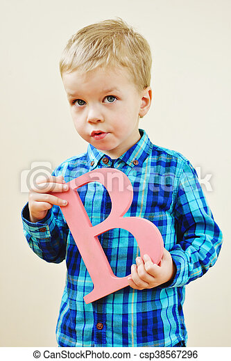 461e9a78ddd3 Toddler blonde boy with a wooden letter b.