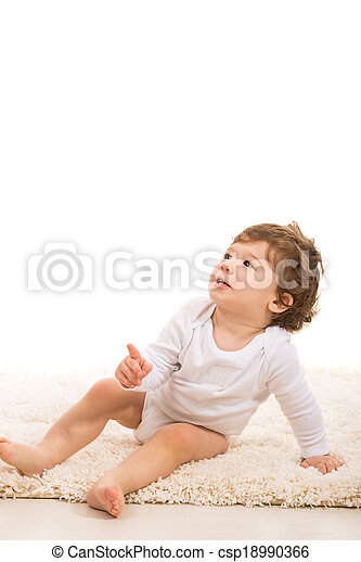 Toddler boy pointing up to copy - csp18990366