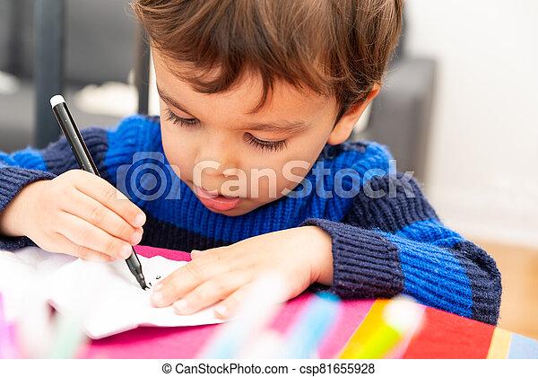 Toddler drawing at home - csp81655928