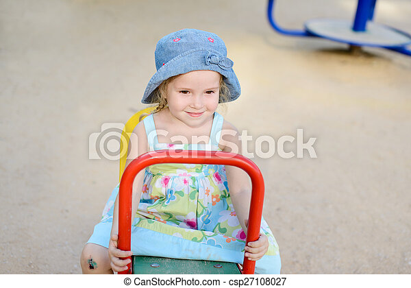 toddler girl on the playground - csp27108027