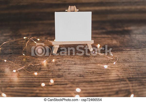 toile, copyspace, miniature, bois, entouré, lumières, bureau noir, fée - csp72466554