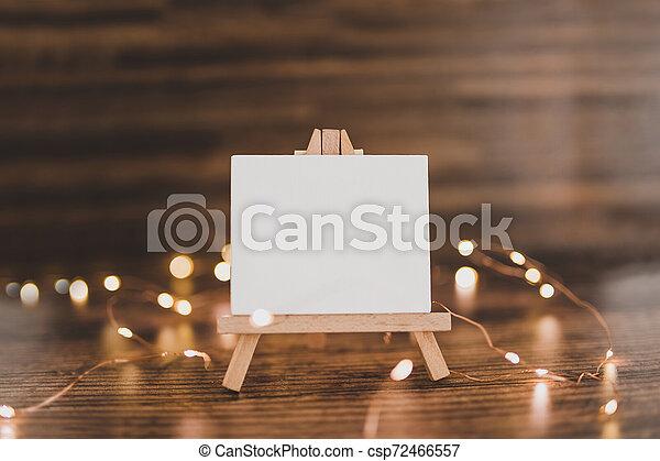 toile, copyspace, miniature, bois, entouré, lumières, bureau noir, fée - csp72466557