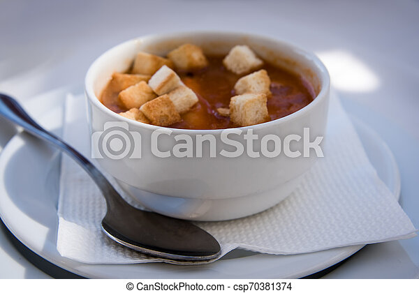 Tomato cream soup with croutons . - csp70381374