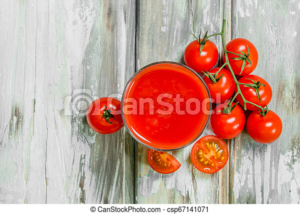 Tomato juice in a glass. - csp67141071