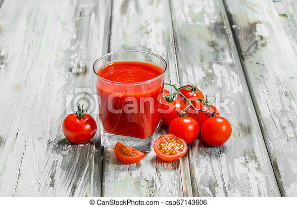 Tomato juice in a glass. - csp67143606