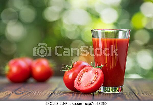 tomato juice in glass - csp74463260
