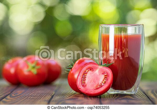 tomato juice in glass - csp74053255