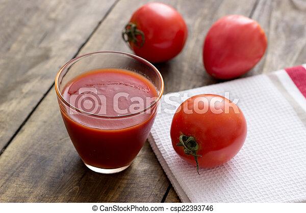 Tomato juice in glass - csp22393746