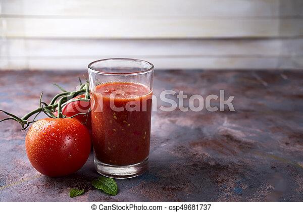 Tomato juice in glass - csp49681737