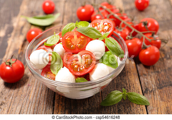 tomato salad with mozzarella and basil - csp54616248