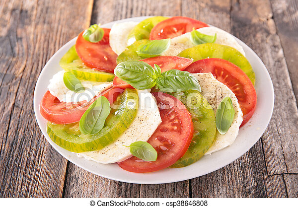 tomato salad with mozzarella and basil - csp38646808