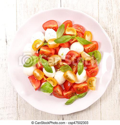 tomato salad with mozzarella and basil - csp47502303