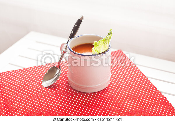 Tomato soup on a red cloth - csp11211724