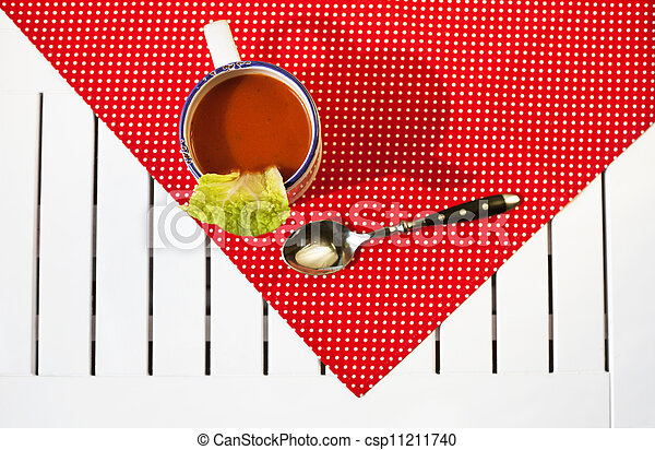 Tomato soup on a red cloth - csp11211740