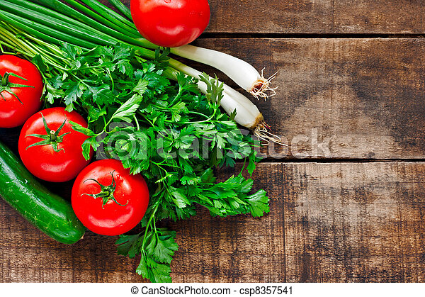 Tomatoes, cucumber, coriander and spring onions on old wooden table - csp8357541